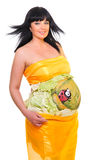 Pregnant woman dressed in yellow tissue Stock Photography