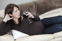 Pregnant woman drinking Royalty Free Stock Image