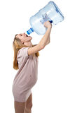 Pregnant woman drinking from bottle Stock Image