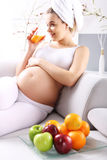 Pregnant woman drinking fruit juice