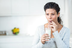 Pregnant woman drinking a glass of milk Royalty Free Stock Image