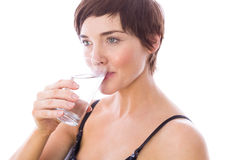 Pregnant woman drinking glass of water Royalty Free Stock Photos