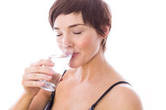Pregnant woman drinking glass of water Stock Photo