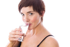 Pregnant woman drinking glass of water Stock Photos