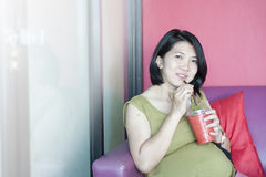 Pregnant woman drinking Royalty Free Stock Photo
