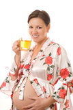 Pregnant woman is drinking tea Stock Images