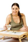 A pregnant woman drinking tea Stock Images