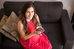 Pregnant woman drinking tea Royalty Free Stock Images
