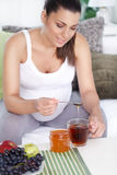 Pregnant woman drinking tea. With honey Stock Photo