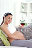 Pregnant woman drinking wine Royalty Free Stock Photos