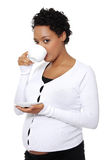 Pregnant woman drinks cafe or tea Royalty Free Stock Images