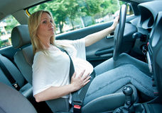 Pregnant woman driving Stock Photo