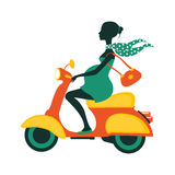 Pregnant woman driving scooter Royalty Free Stock Image