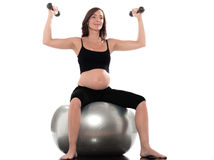 Pregnant Woman Dumbbells Exercise royalty free stock photography