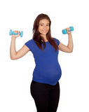 Pregnant woman with dumbbells Stock Images