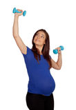Pregnant woman with dumbbells Royalty Free Stock Image