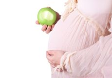 Pregnant woman eat apple Stock Photo
