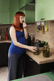 Pregnant woman eat pickles Royalty Free Stock Photography