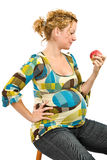 Pregnant woman eating apple Stock Photography