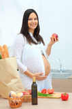 Pregnant woman eating the apple Royalty Free Stock Image