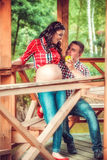 Pregnant woman eating apple with the husband outdoor Stock Photography