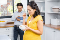 Pregnant woman eating cereals Royalty Free Stock Photos
