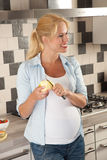 Pregnant woman eating healthy Stock Photos