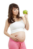 Pregnant woman eating healthy food stock images
