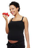 Pregnant woman eating healthy food. Stock Image