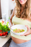 Pregnant woman eating healthy muesli Royalty Free Stock Photography