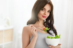 Pregnant Woman Eating Healthy Salad. Beautiful Female With Baby Belly On Diet Nutrition. High Resolution Royalty Free Stock Photo