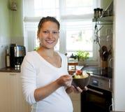 Pregnant woman eating salad Royalty Free Stock Image