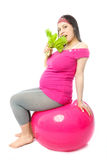 Pregnant woman eating salad Royalty Free Stock Photography