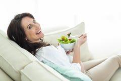 Pregnant woman eating salad Stock Image