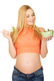 Pregnant woman eating salad Royalty Free Stock Photo