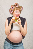 Pregnant Woman Eating a Sandwich Stock Photography