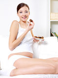 Pregnant woman eating sweet cookies Stock Photo