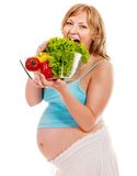 Pregnant woman eating vegetable. Royalty Free Stock Photos