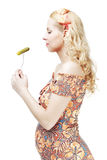 Pregnant woman eats pickled cucumber Royalty Free Stock Images