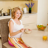 Pregnant woman eats soup Royalty Free Stock Image