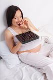Pregnant woman eats sweets Royalty Free Stock Photo
