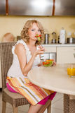 Pregnant woman eats vegetable salad Stock Image