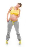 Pregnant woman engaged in fitness Stock Images