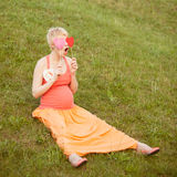 Pregnant woman enjoying summer park Royalty Free Stock Photography