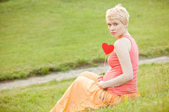 Pregnant woman enjoying summer park Stock Photo