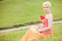 Pregnant woman enjoying summer park Royalty Free Stock Photo