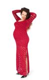 Pregnant woman in evening dress Stock Photo