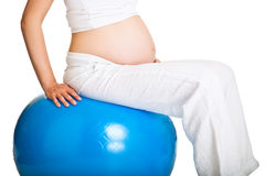 Pregnant woman excercises Stock Photos