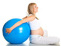 Pregnant woman excercises Stock Photography