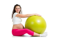 Pregnant woman excercises with fit ball Royalty Free Stock Photo